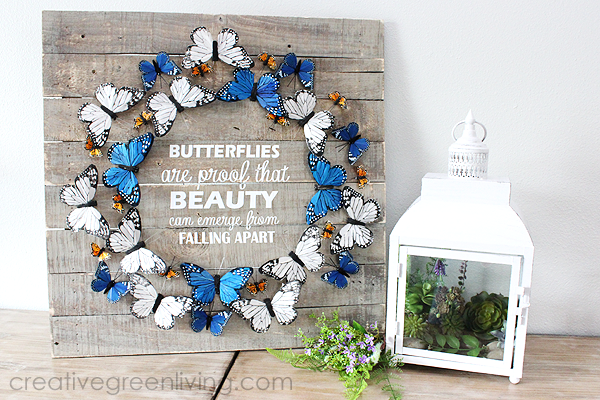Farmhouse style butterfly decor ideas - indoor wreath on a pallet board with saying 'butterflies are proof that beauty can emerge from falling apart' from CreativeGreenLiving -- SlayAtHomeMother.com