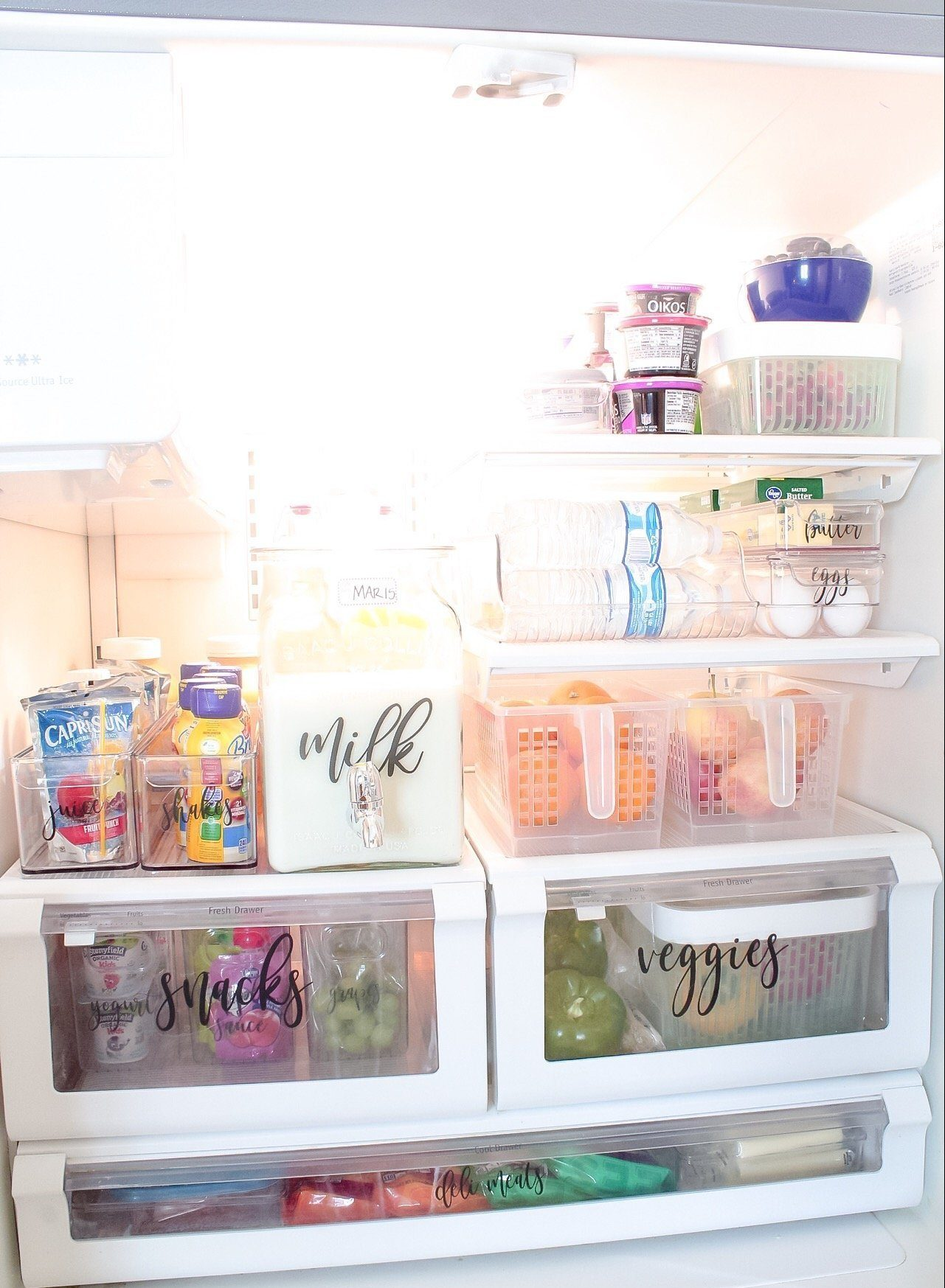 My completely organized fridge, with veggies and fruit in bins, milk in a new container, etc.