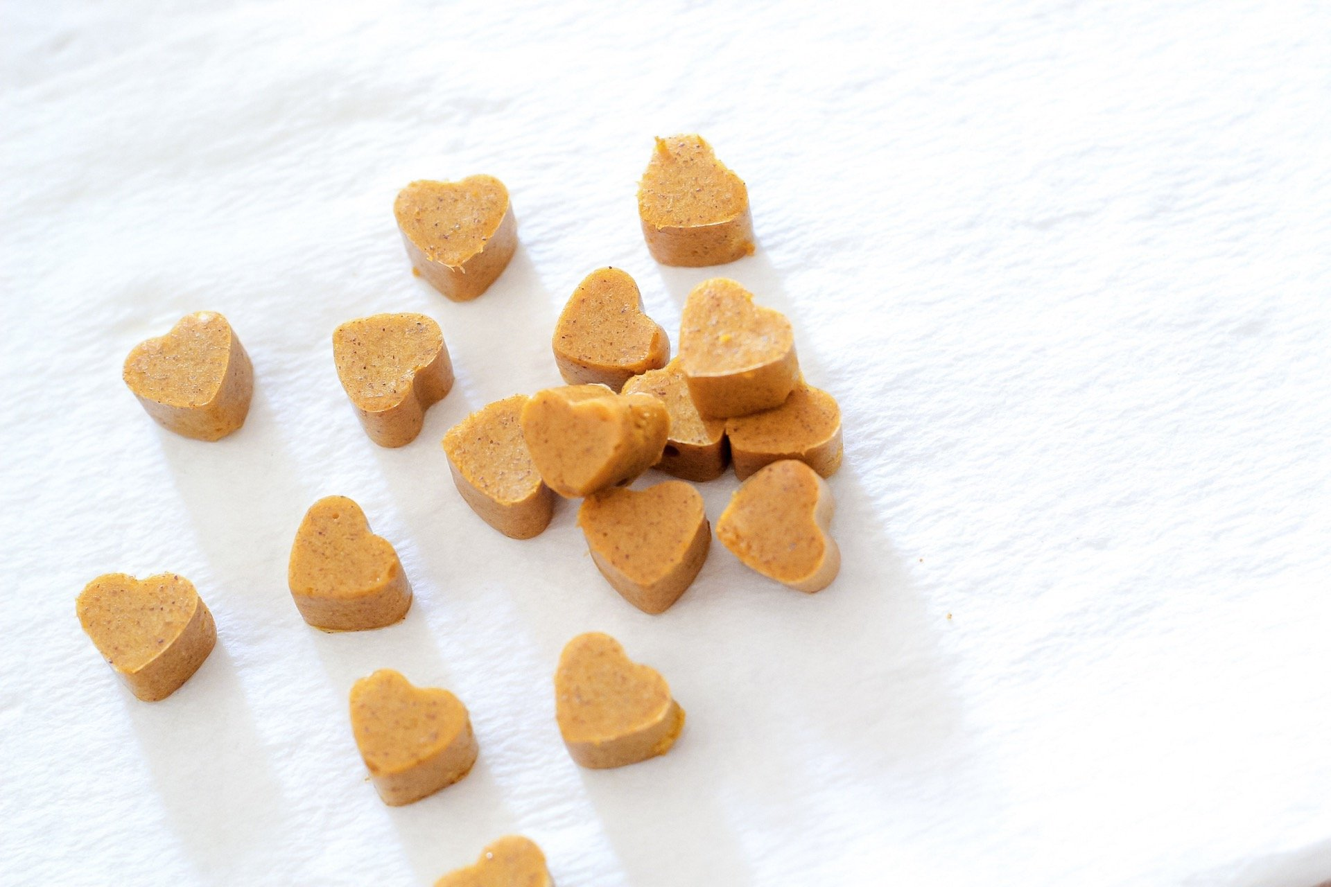 Homemade gummies ready to eat! They are a golden honey color with tiny flecks of brown from the cinnamon