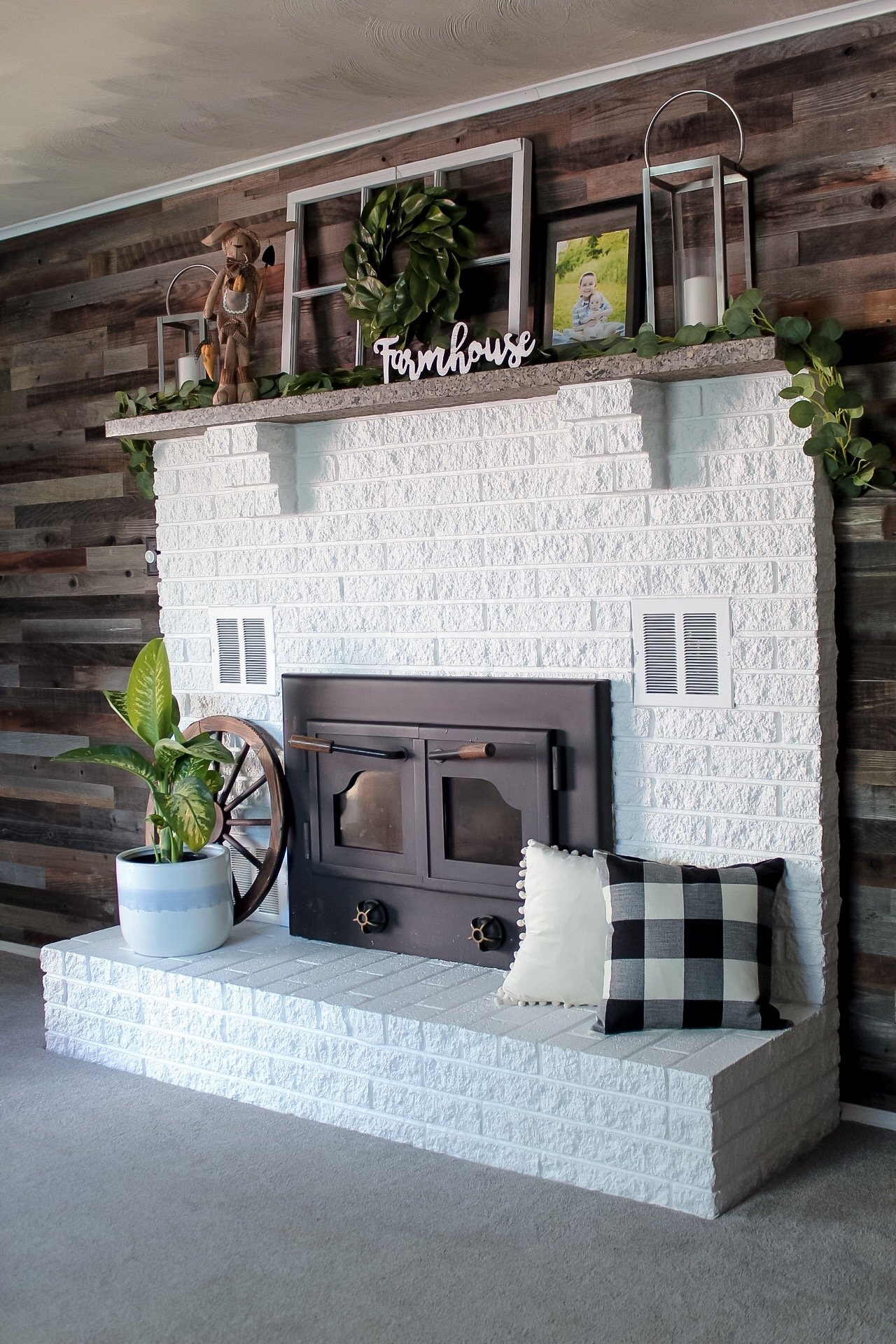 Our painted fireplace in the color Extra White (SW-7006), decorated with farmhouse decor