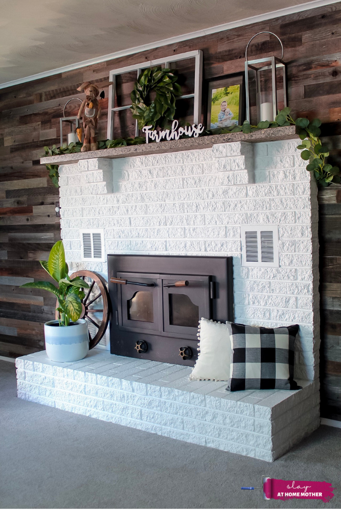 AFTER shot of our white fireplace decorated with farmhouse decor