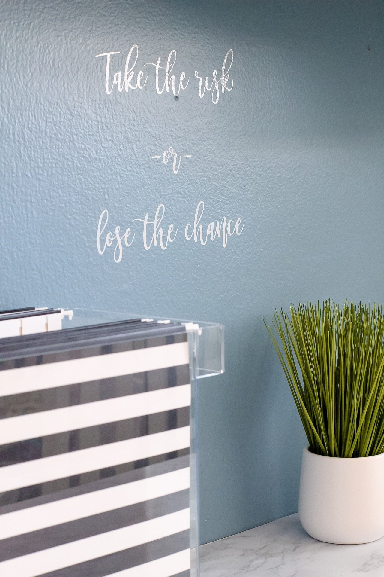 White wall decal that reads: Take the risk or lose the chance