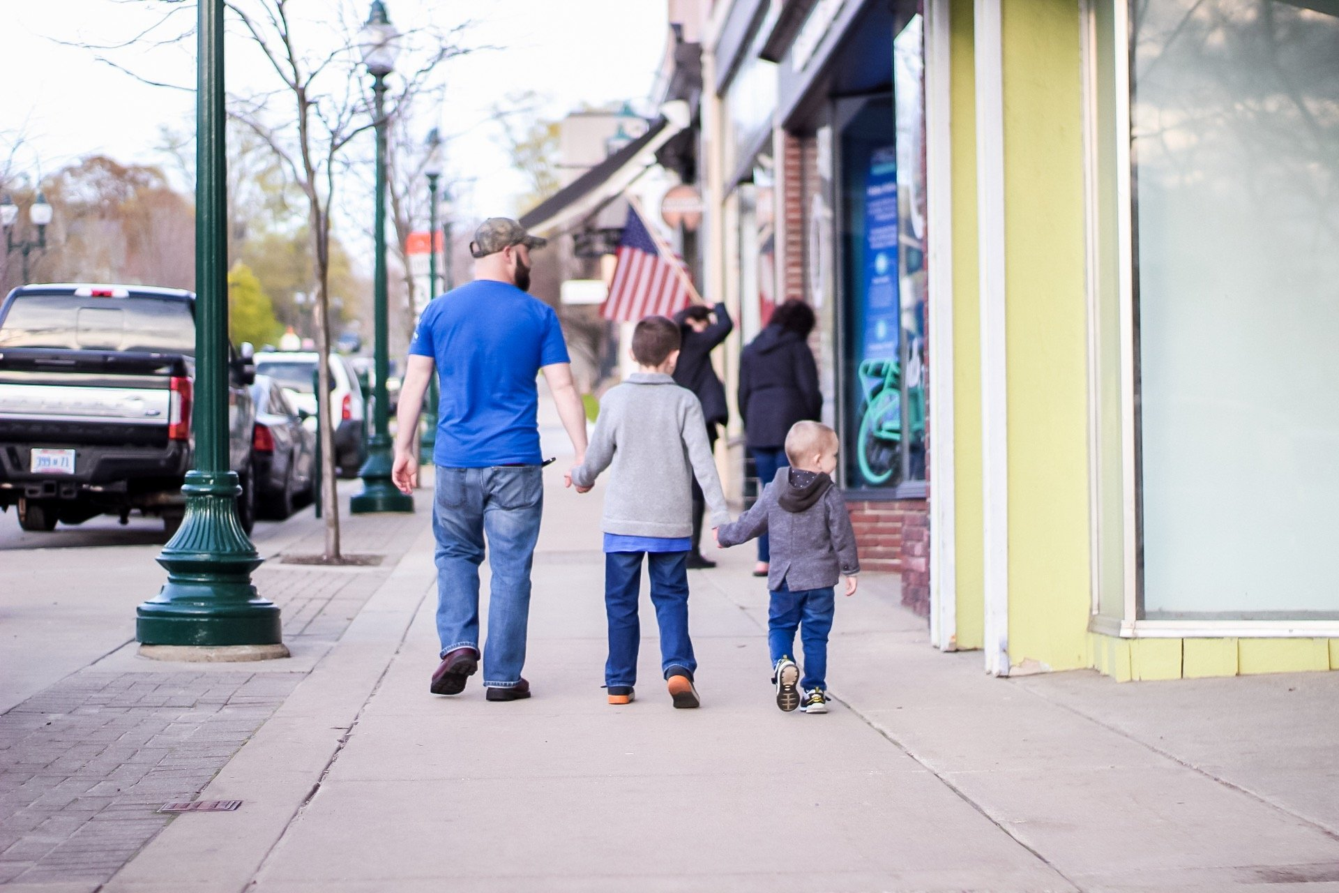 boys walking downtown petoskey, michigan