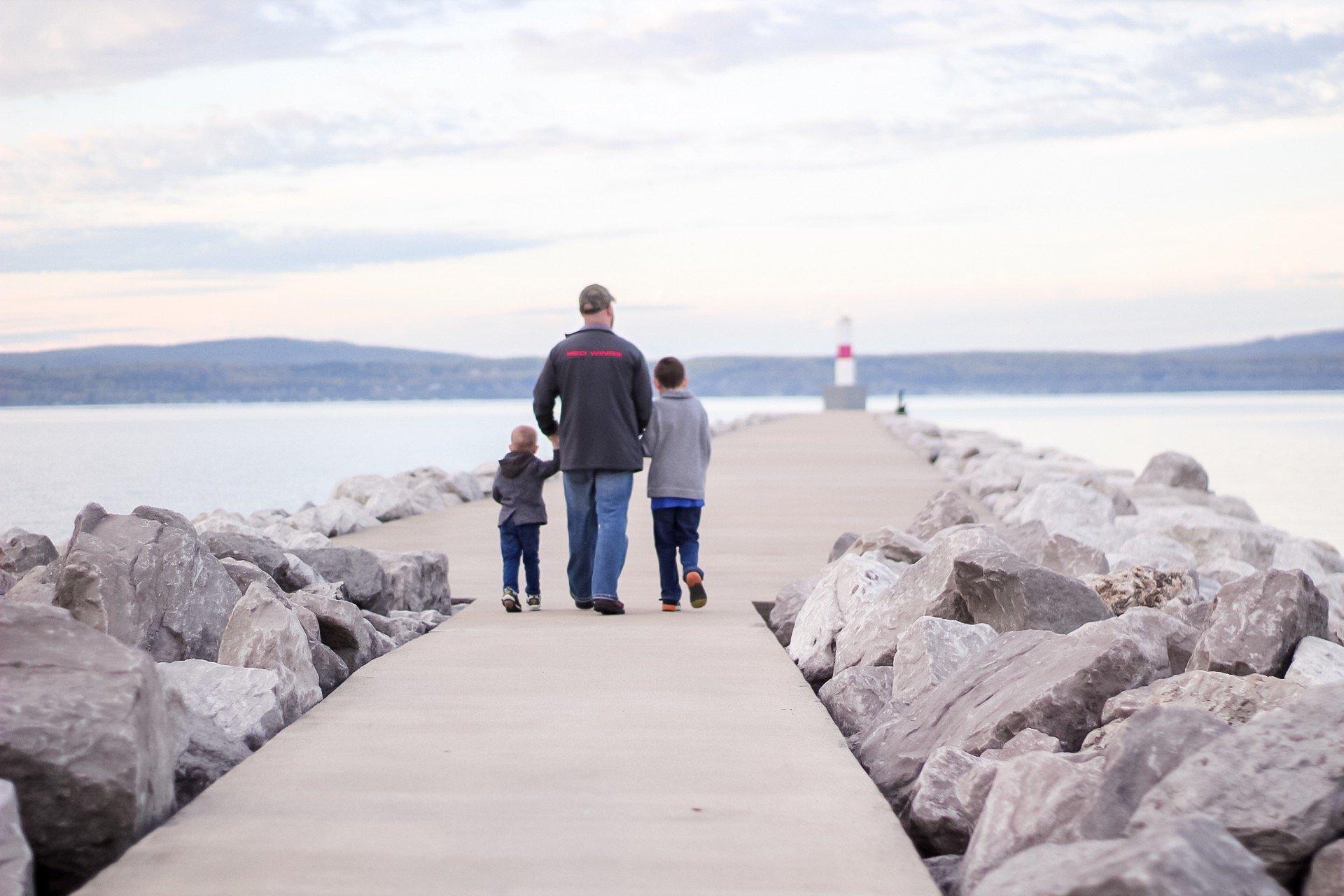 family walking the pier in petoskey mi