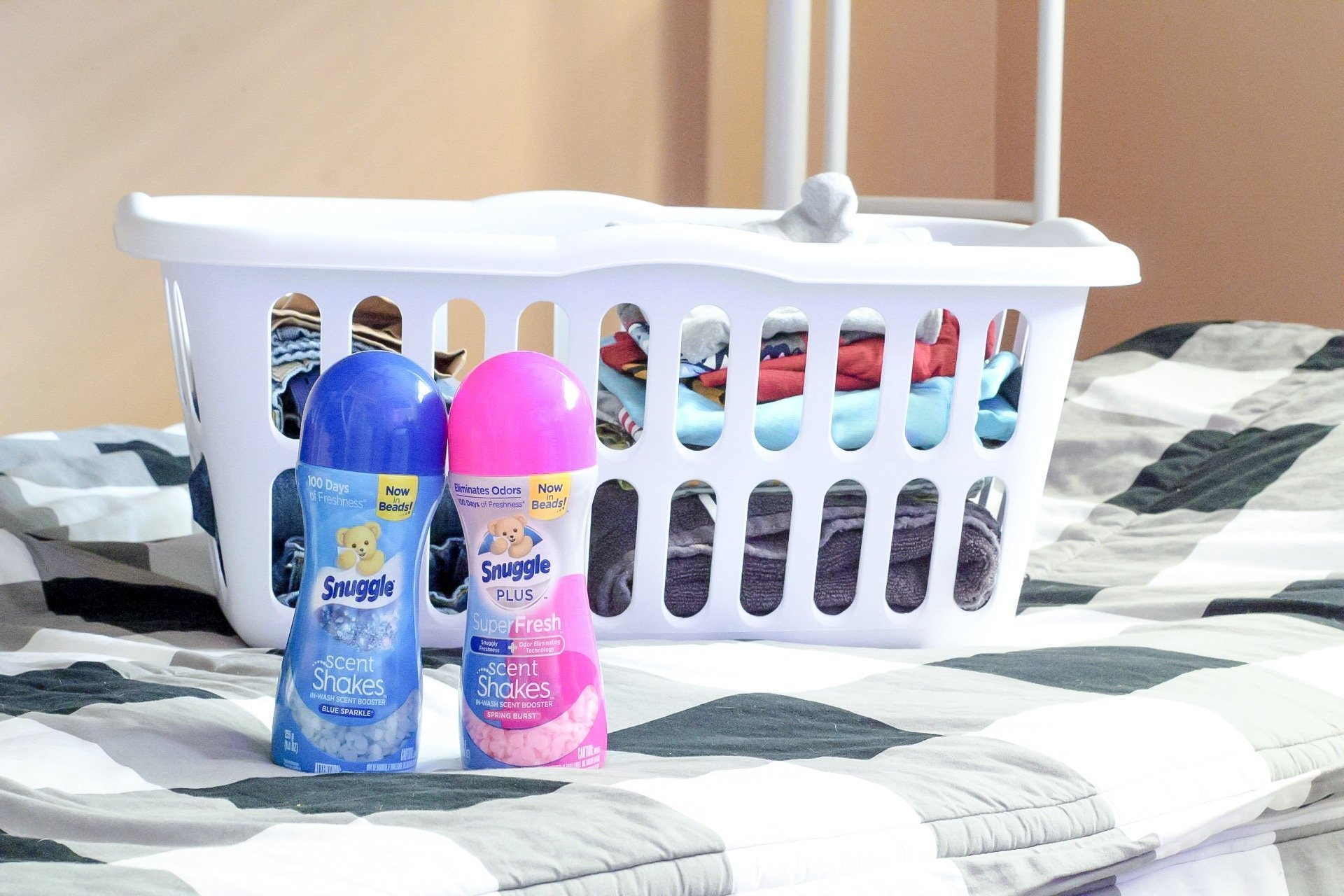 Snuggle Scentshakes next to a laundry basket of folded clothes