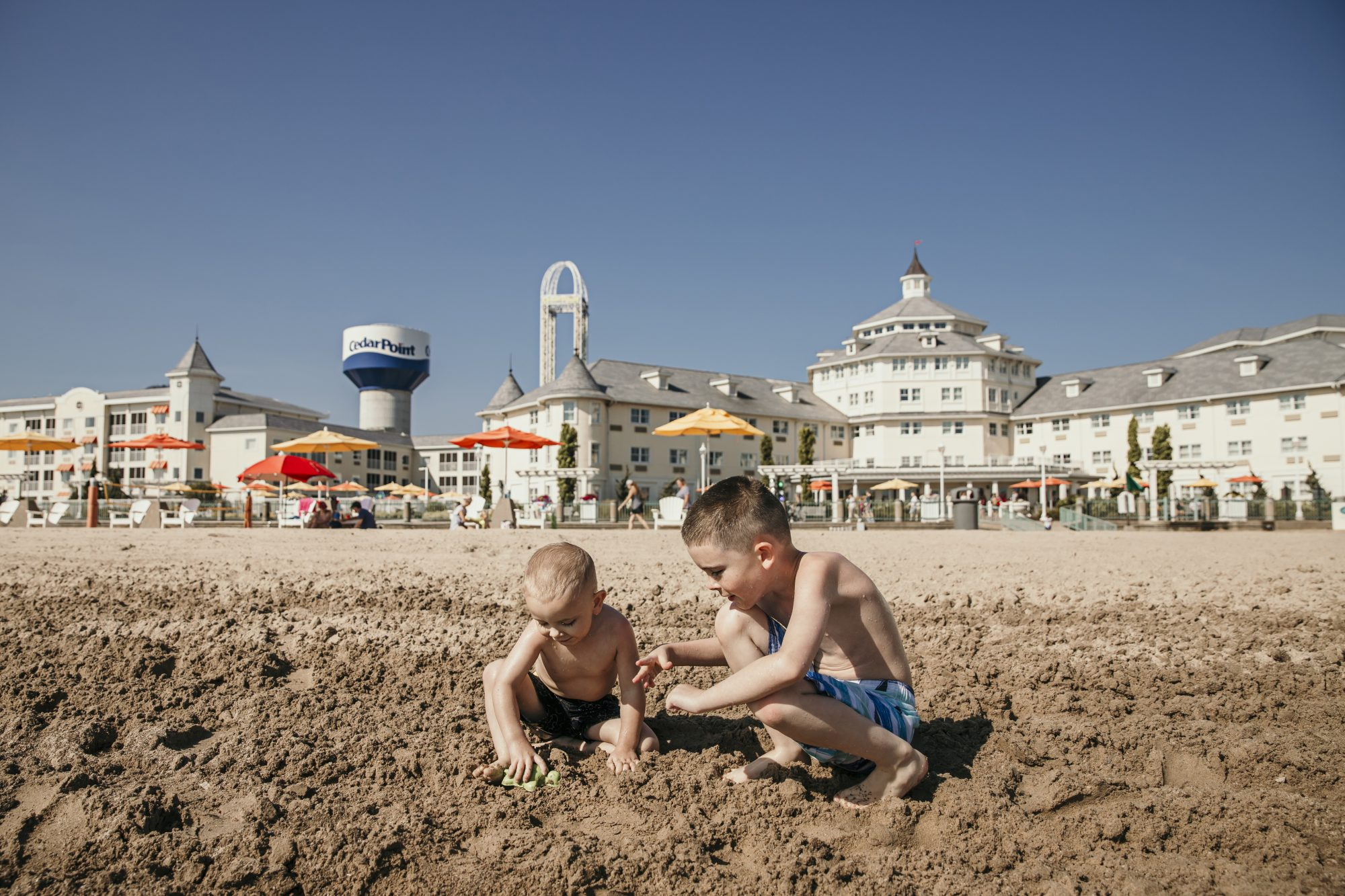 playing in the sand at hotel breakers in cedar point
