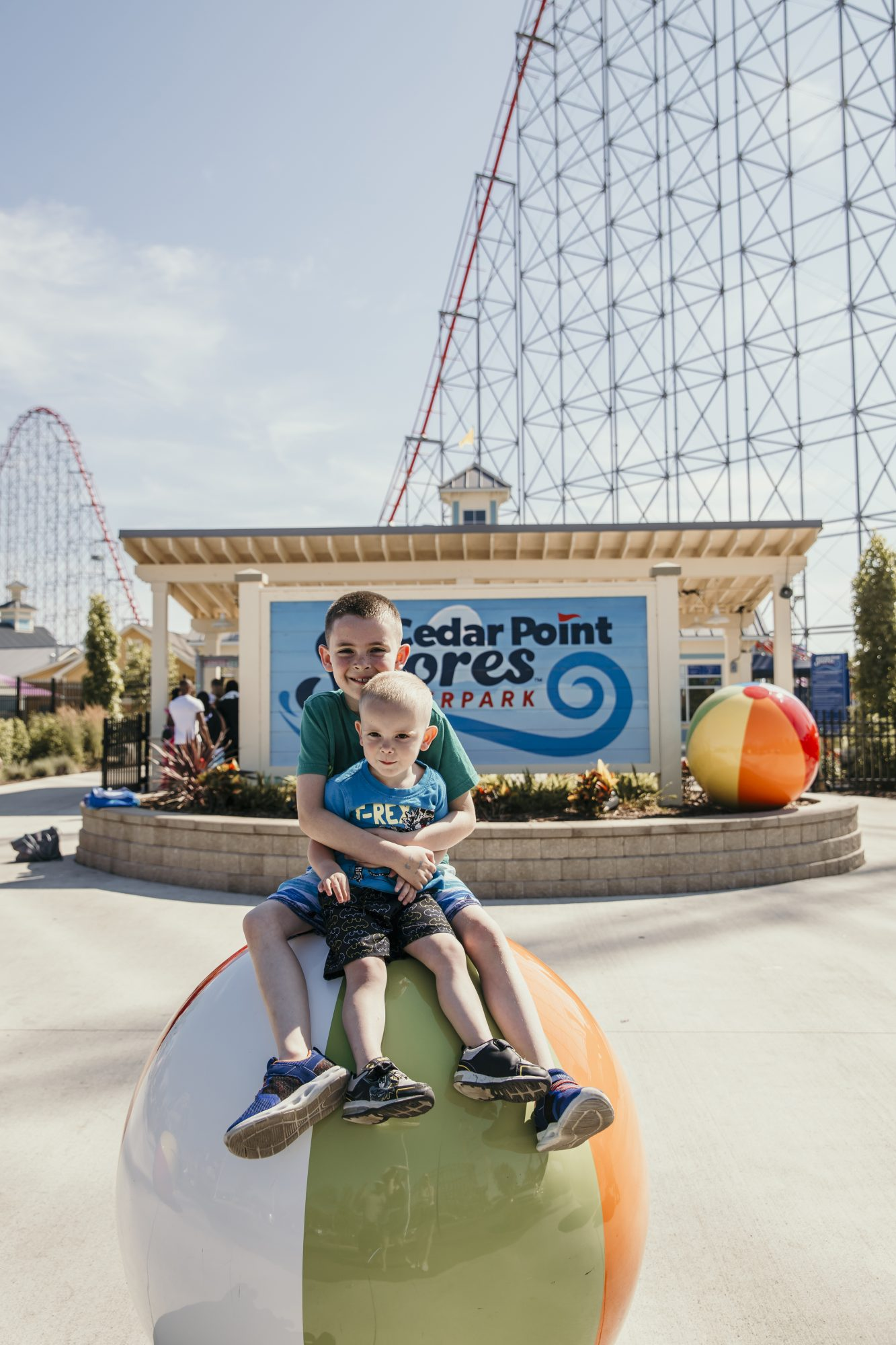 the boys in front of cedar point shores sign