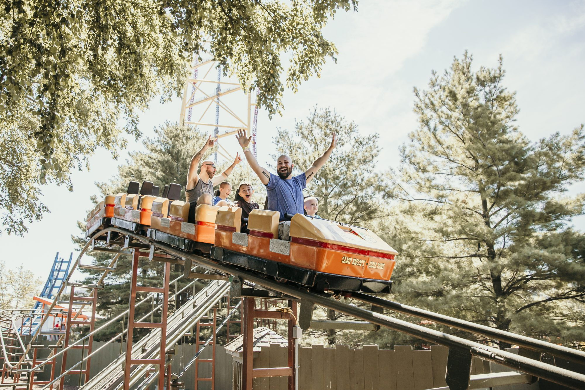 riding a roller coaster together