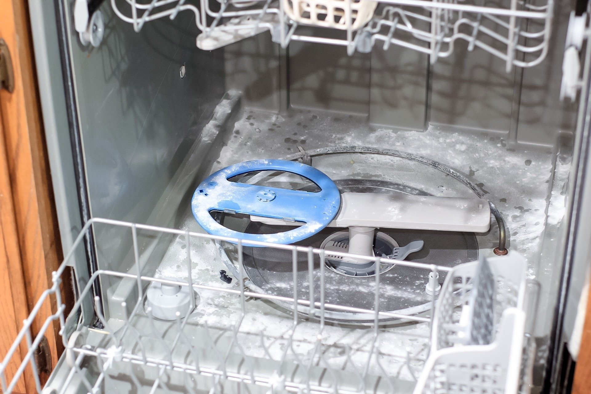baking soda sprinkled on floor of dishwasher