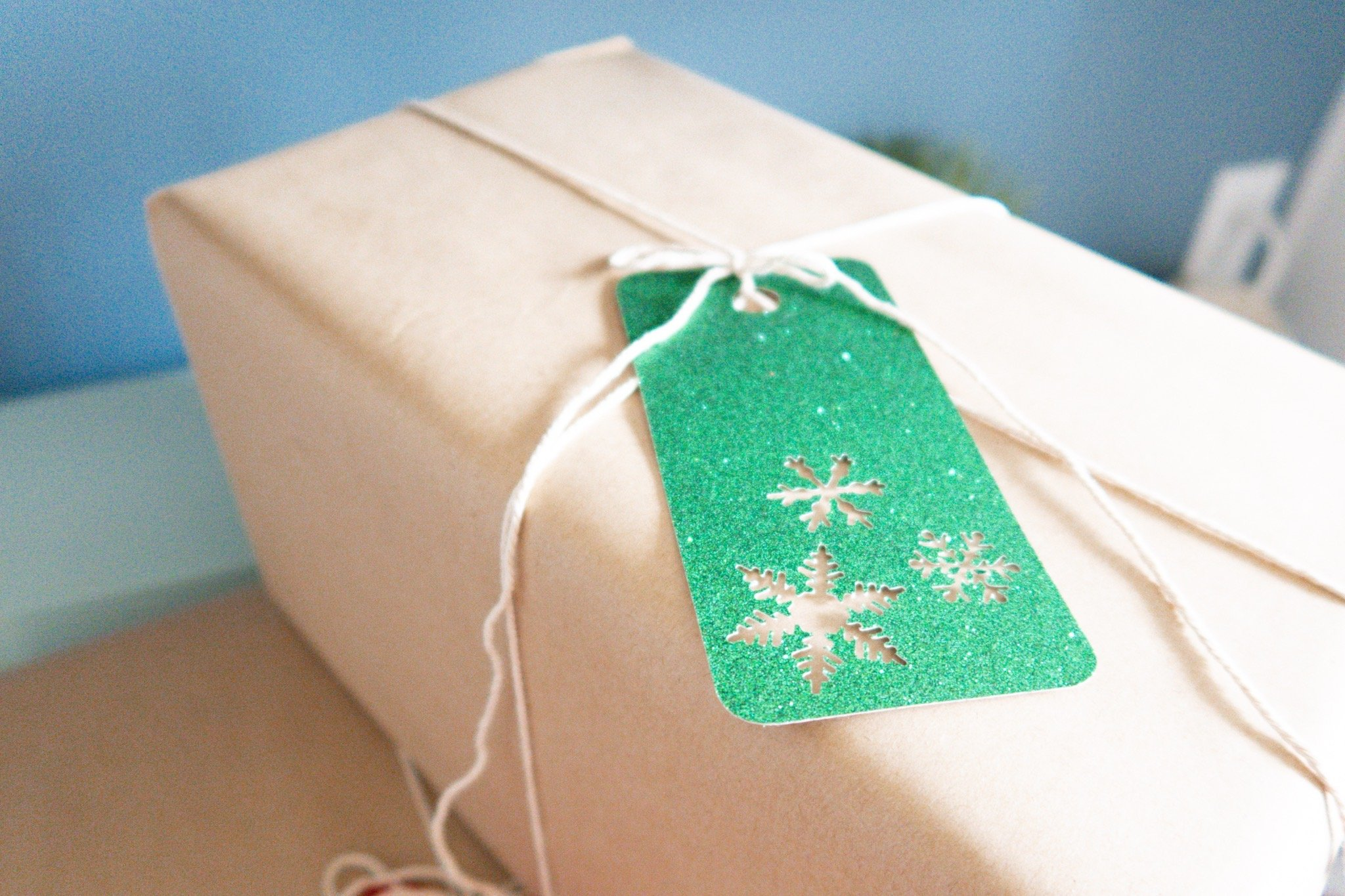 christmas presents wrapped and topped with gift tag