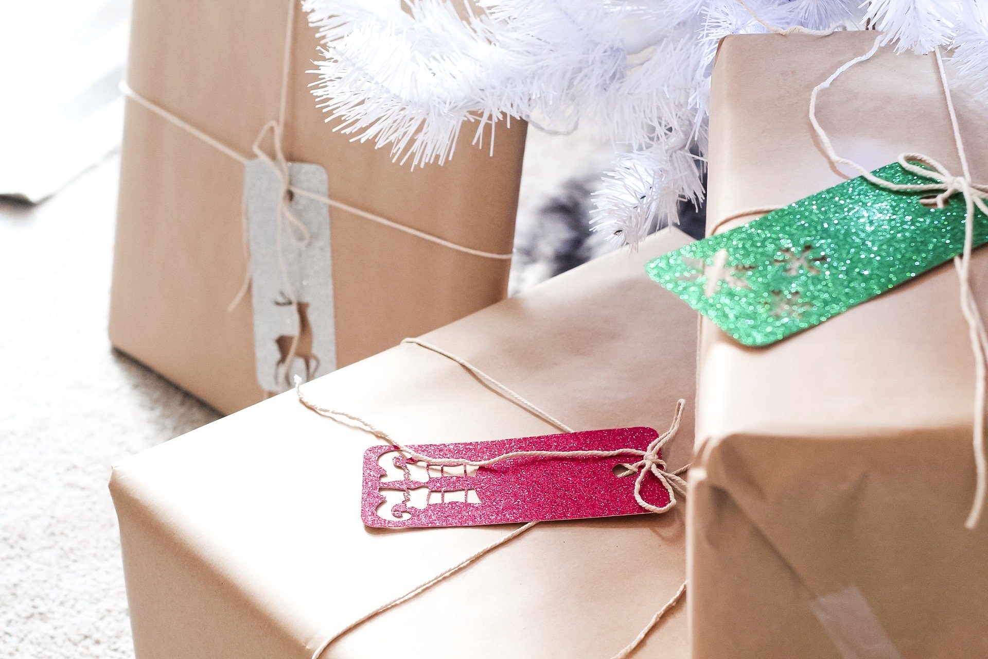closeup of diy glitter christmas gift tags