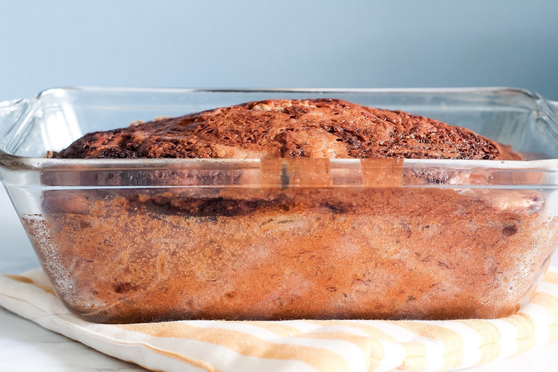 side view of zucchini banana bread in loaf pan