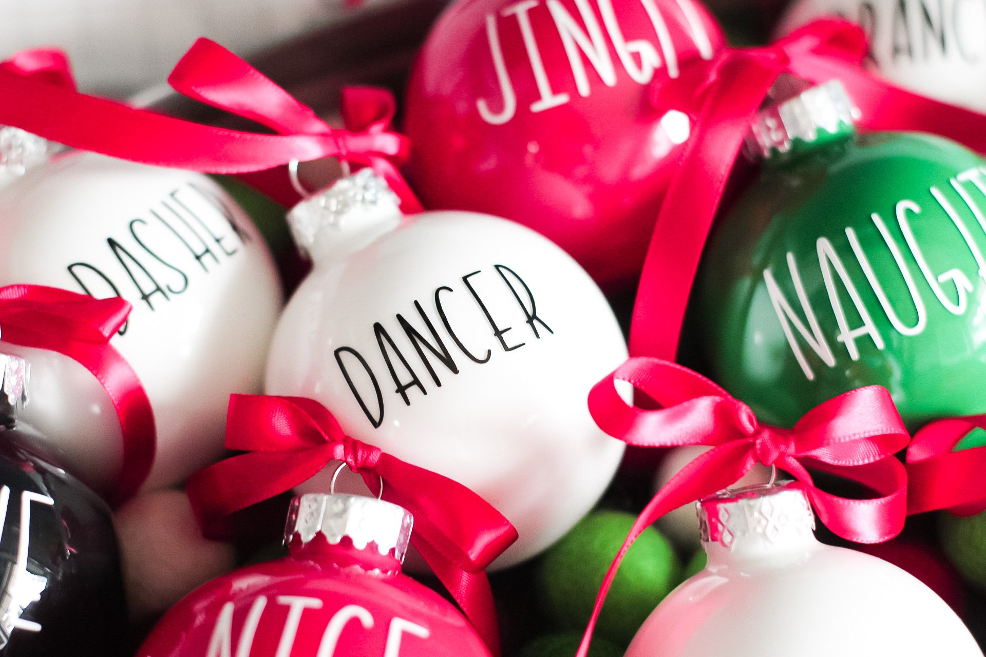 closeup of vinyl letters on painted christmas ornaments