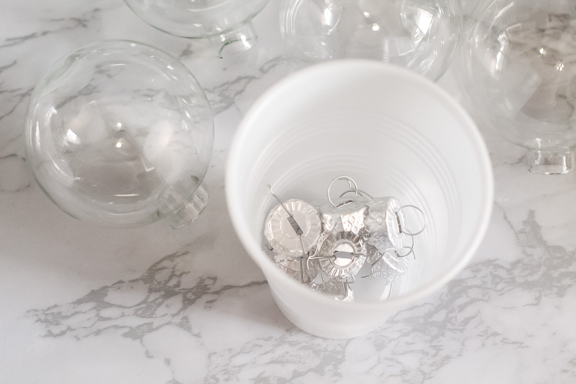glass ornament tops removed and placed in a cup
