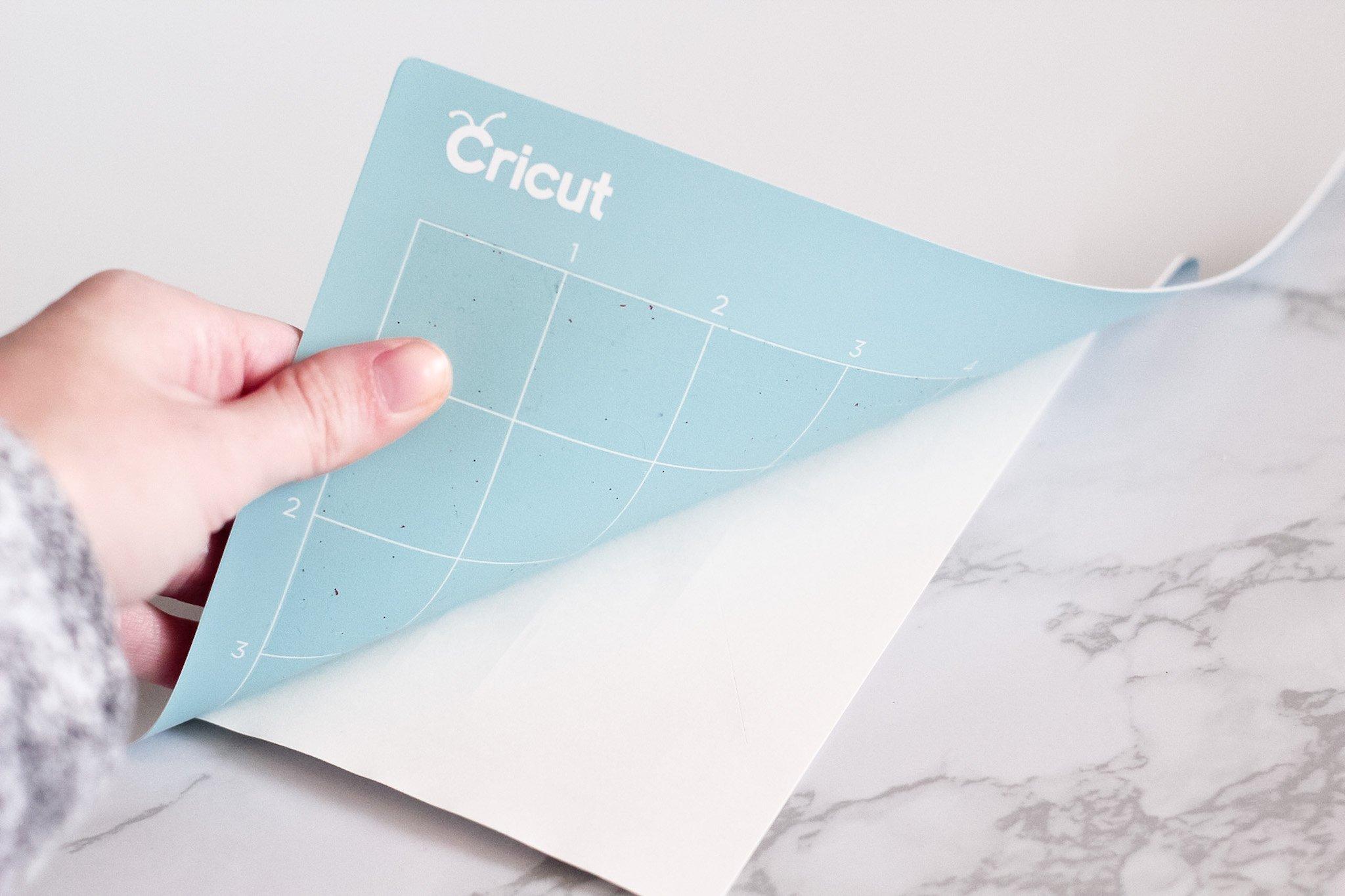 peeling mat away from sticker paper after cutting