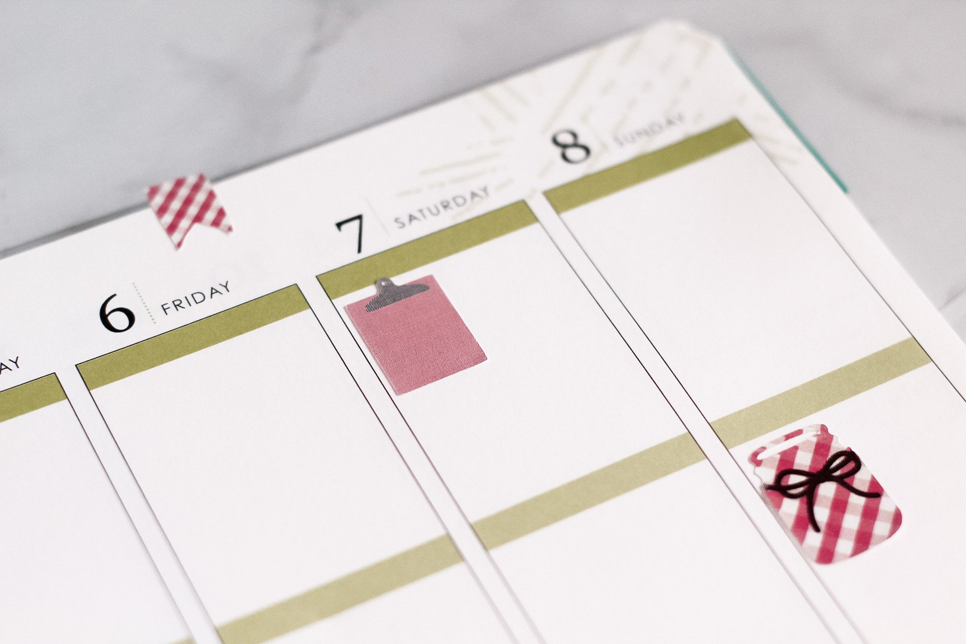 plaid and red stickers on planner page