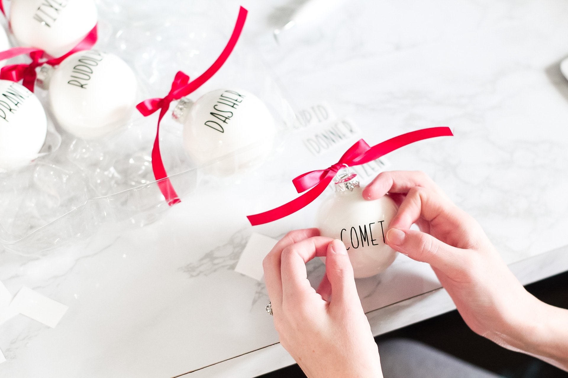 position vinyl letters on ornament with transfer tape