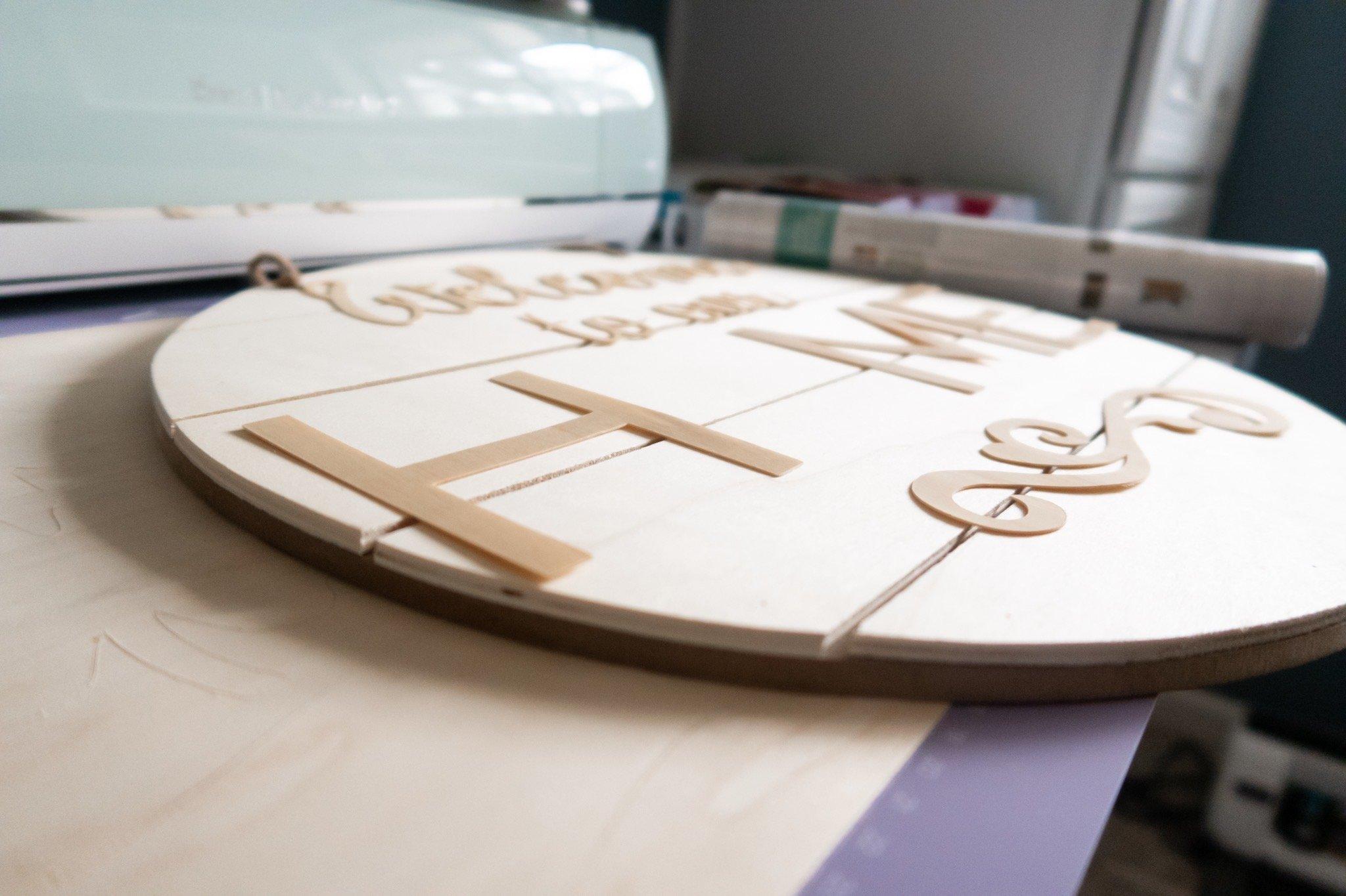 side view of cut wood veneer letters