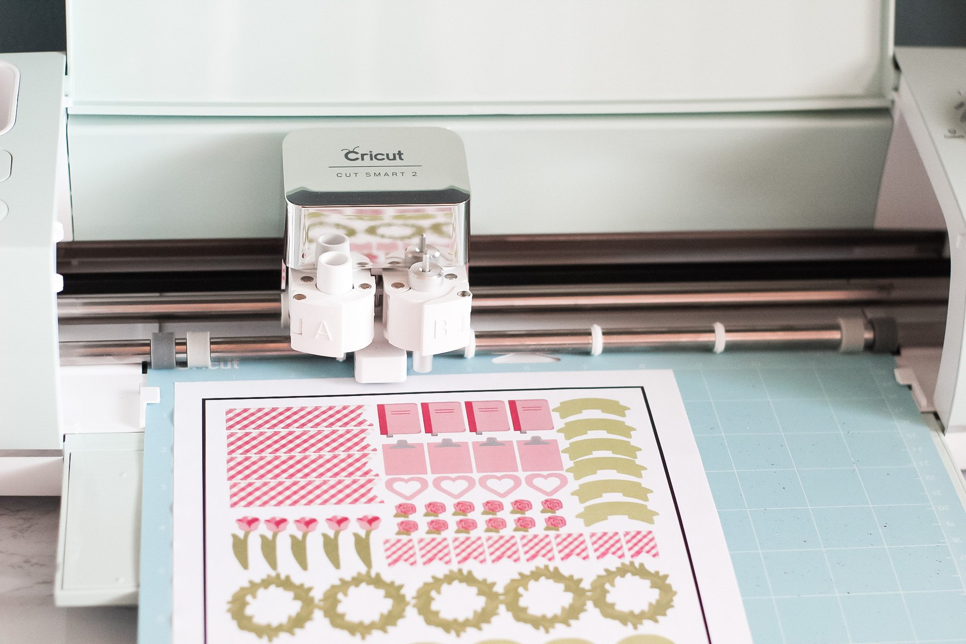 sticker paper and lightgrip mat loaded into cricut explore air 2