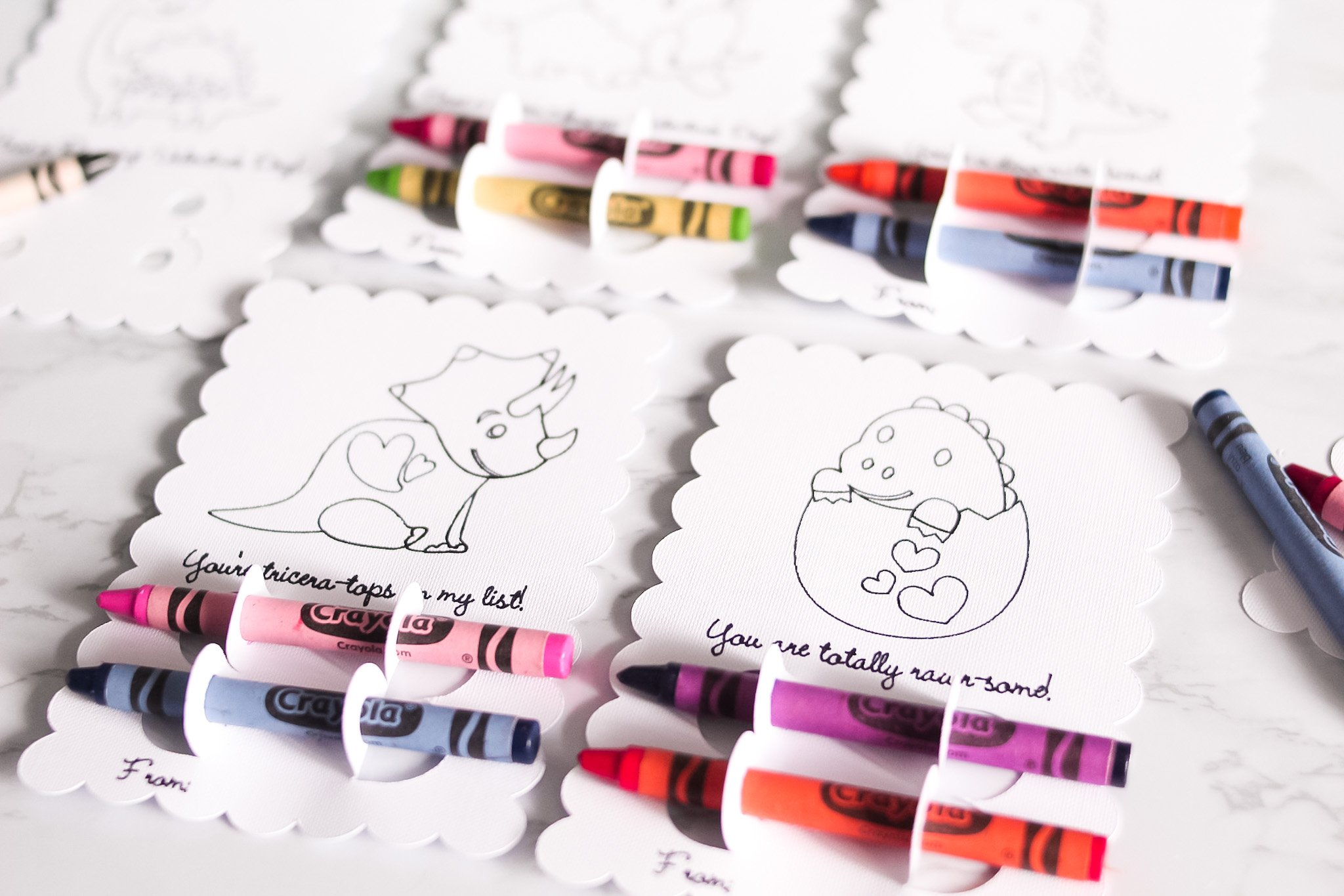 crayons inserted into crayon holders of cards