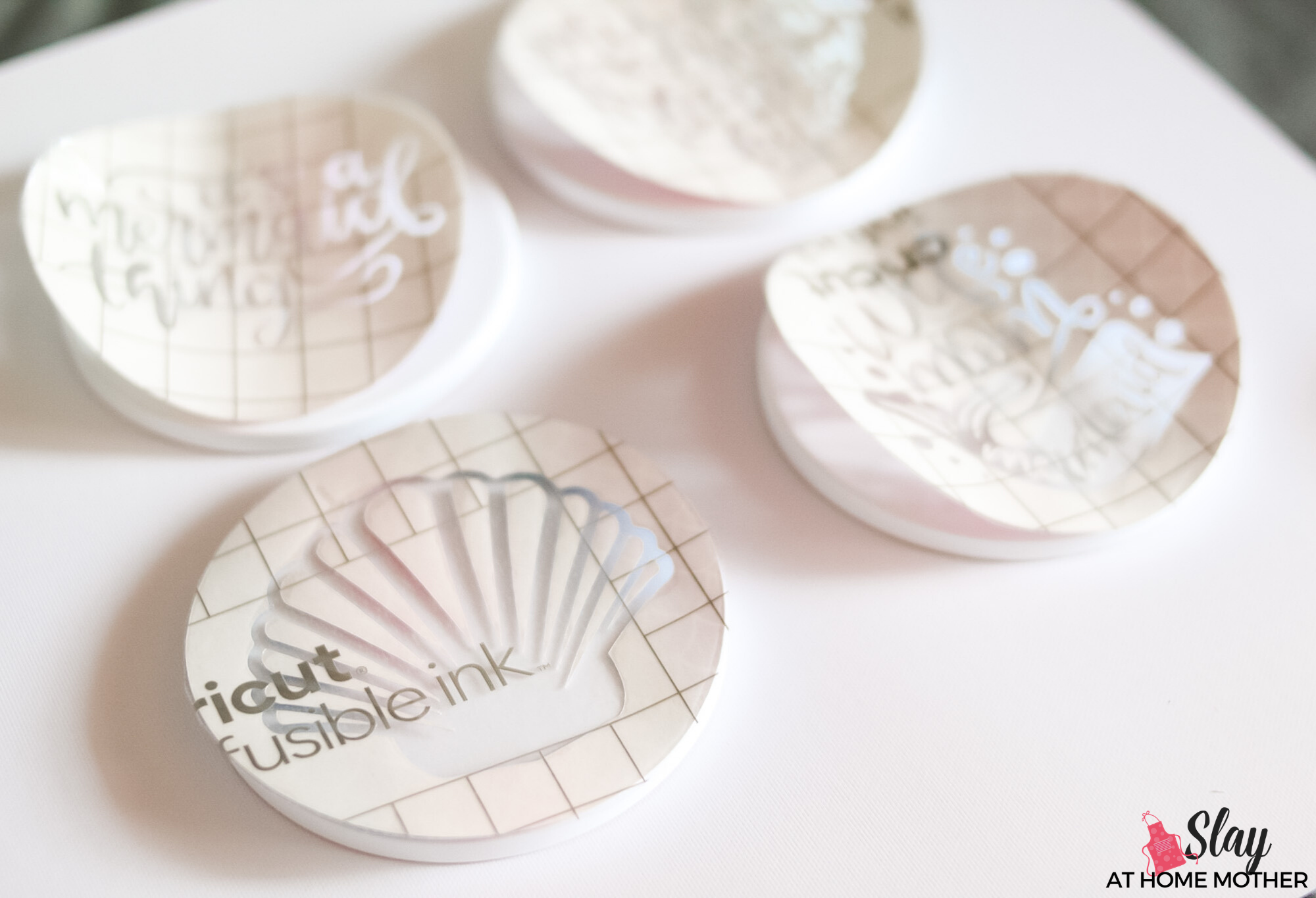 infusible ink transfer sheets on top of cricut coasters
