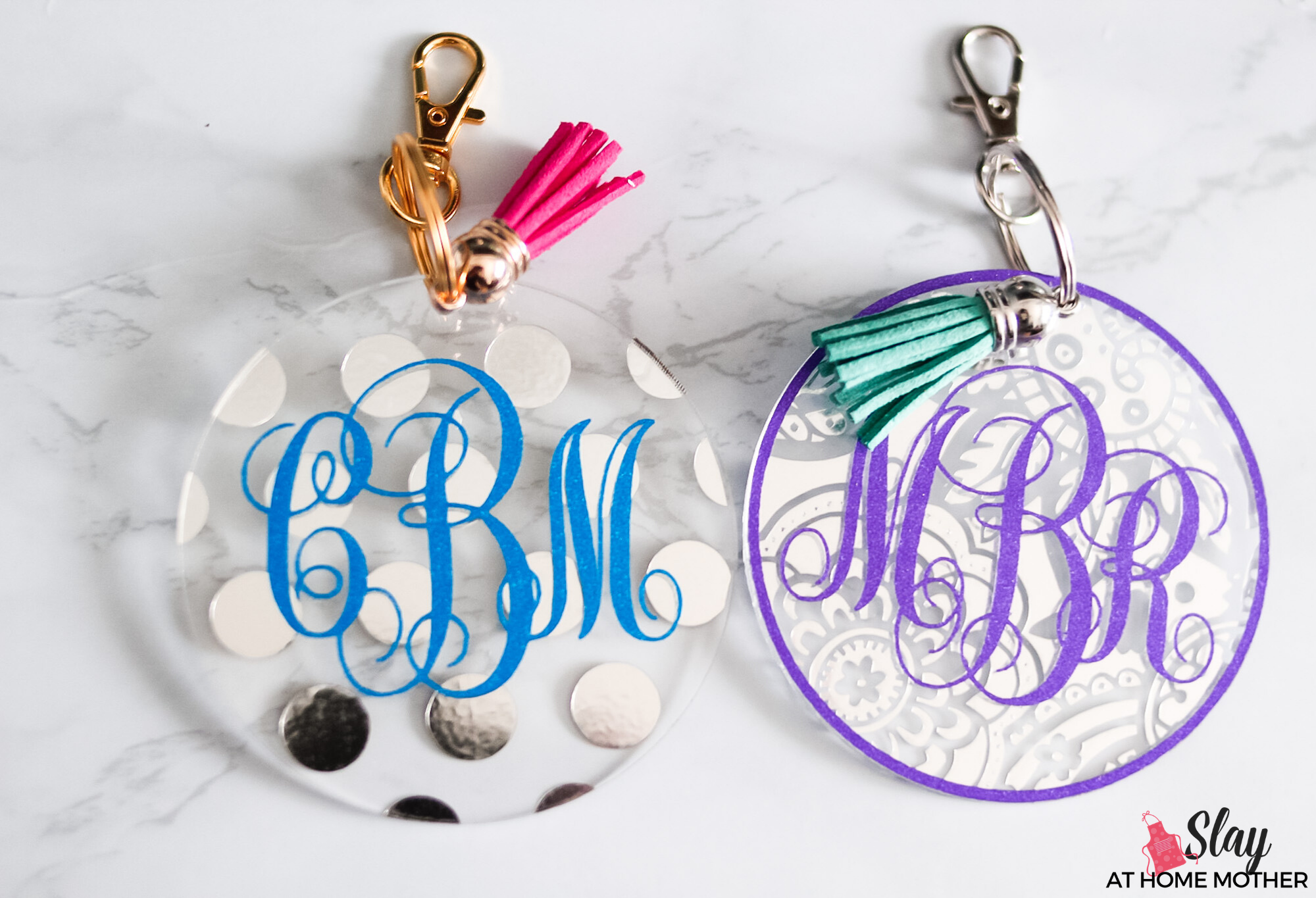 finished monogram keychains with silver and gold hardware and tassels blue purple