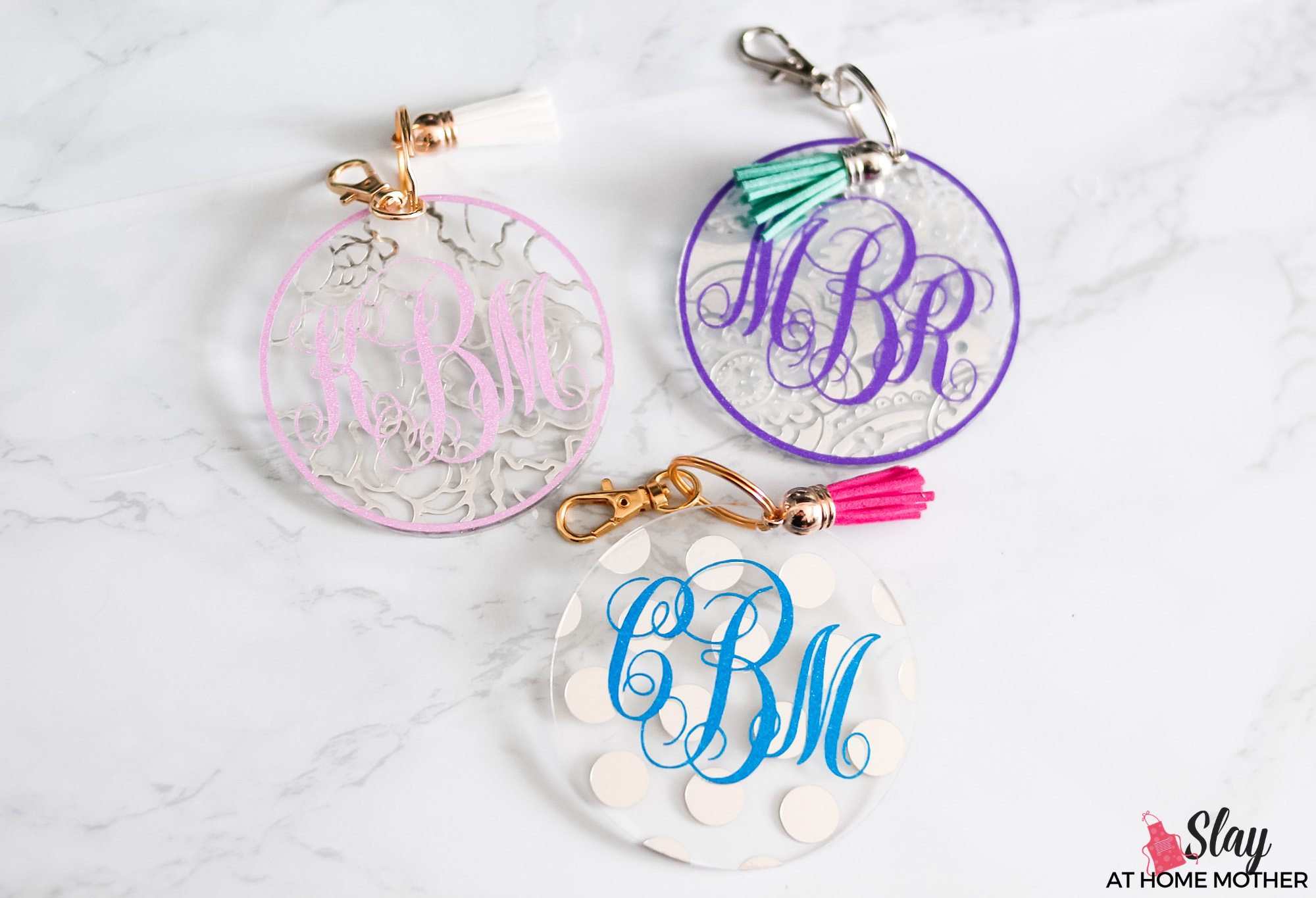 finished monogram keychains with silver and gold hardware and tassels