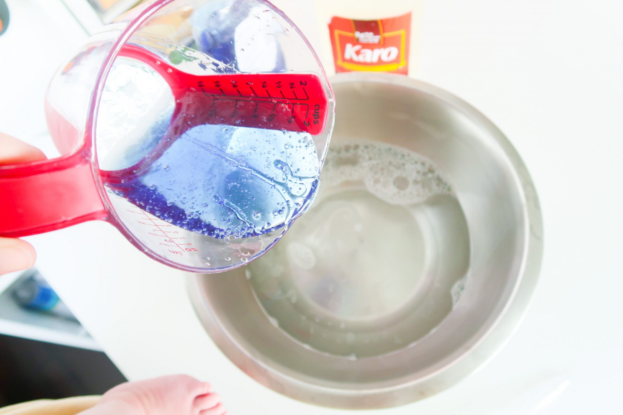 pouring Dawn dish soap into mixing bowl