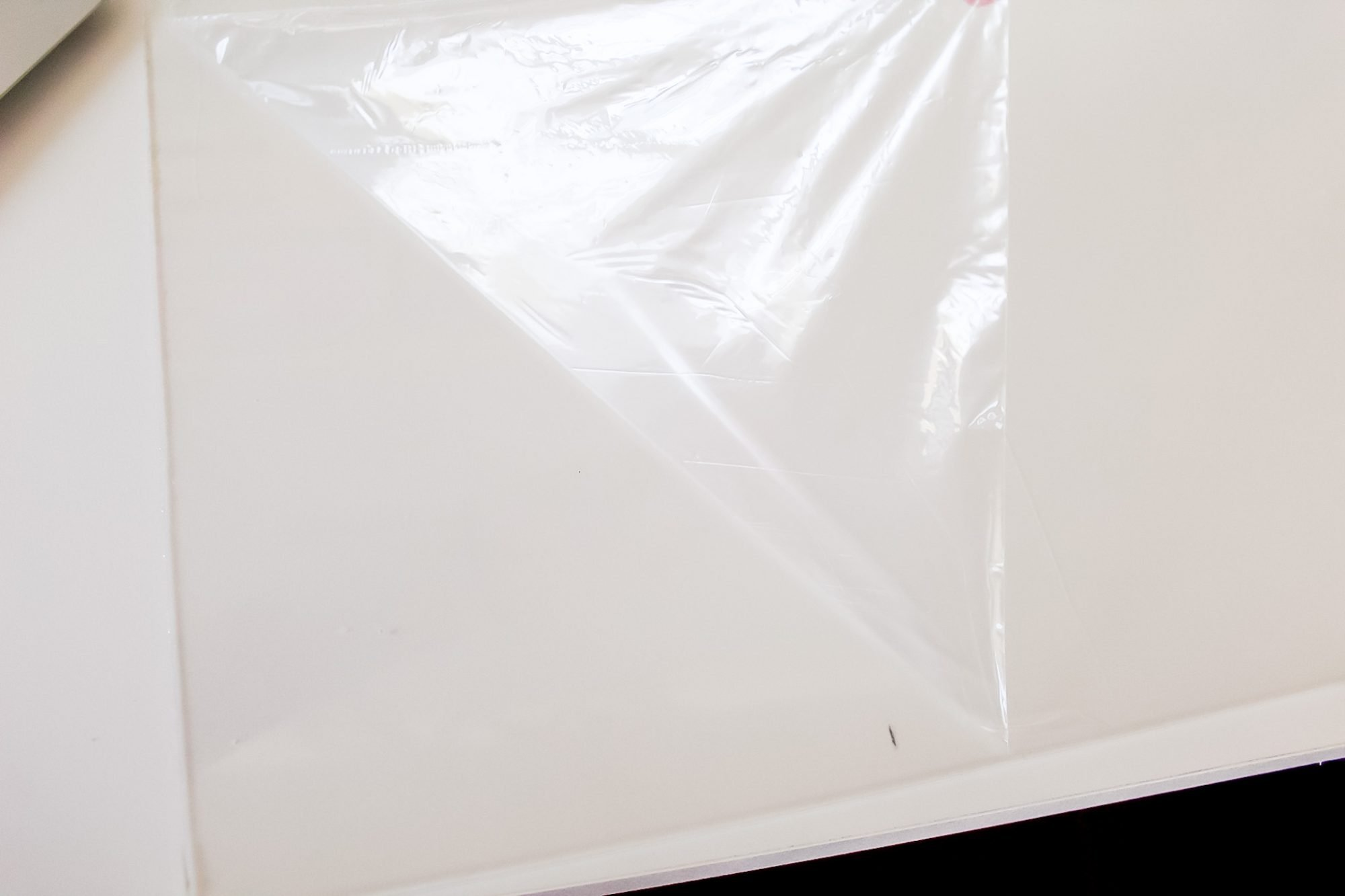 peeling liner off acrylic sheet