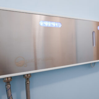 o3 waterworks laundry system installed on wall